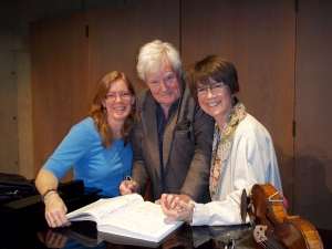 Pamela, Norman and Ann examining the Brahms Double Concerto score